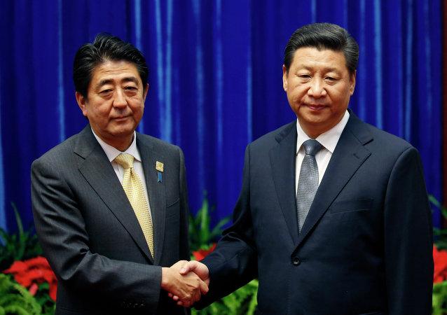 Shinzo Abe e Xi Jinping