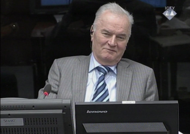In this image taken from video former Bosnian Serb army commander Gen. Ratko Mladic smiles during his appearance at the Yugoslav war crimes tribunal Tuesday Jan. 28, 2014 in the Hague Netherlands