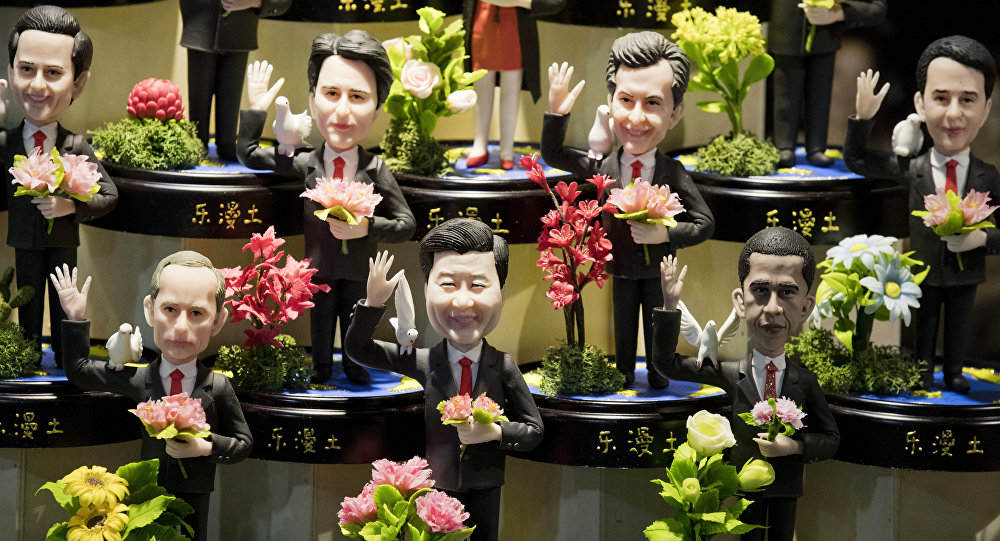 Estatuetas dos líderes mundiais