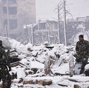 Agentes das forças pró-governamentais sírias na cidade de Aleppo, Síria, 21 de dezembro de 2016