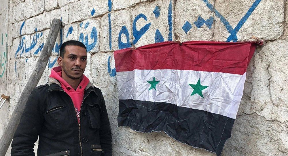 Um habitante de Aleppo oriental após seu bairro ter sido libertado