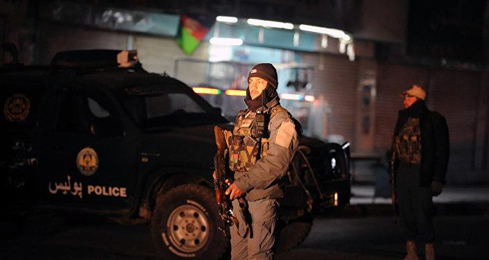 Policial afegão em local de explosão em Kandahar (arquivo)
