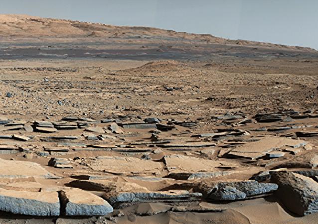 Superfície de Marte, o Planeta Vermelho, cuja atmosfera é rarefeita e a pressão sobre ela varia de 30 Pa a 1155 Pa