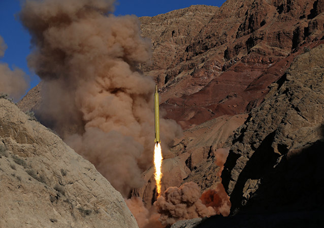 In this photo obtained from the Iranian Fars News Agency, a Qadr H long-range ballistic surface-to-surface missile is fired by Iran's powerful Revolutionary Guard, during a maneuver, in an undisclosed location in Iran, Wednesday, March 9, 2016