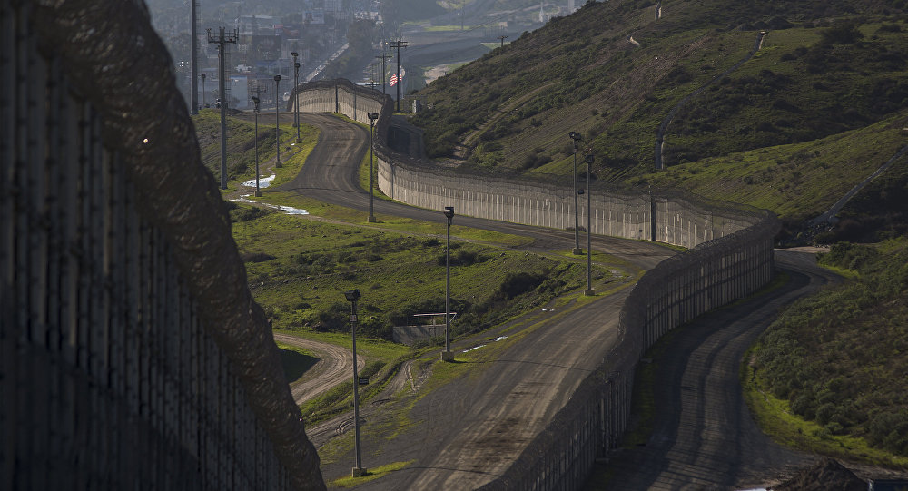 Multiple layers of steel walls, fences, razor wire and other barricades are viewed from the United States side of the of the US-Mexico border on January 26, 2017 in San Ysidro, California