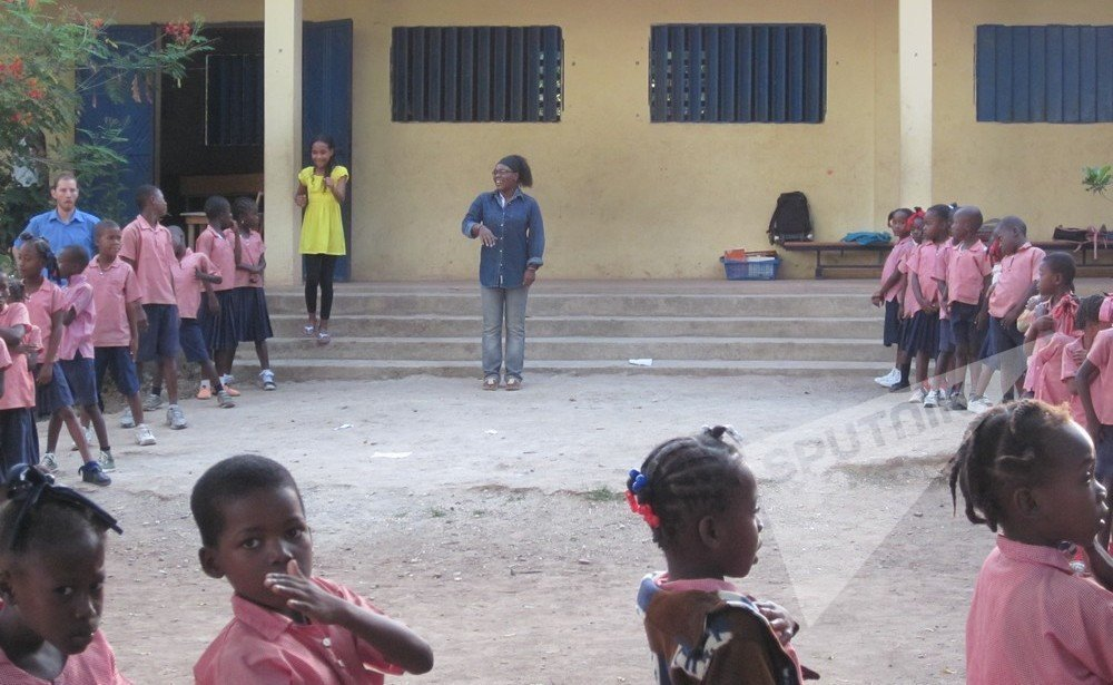 Gene durante trabalho voluntário no Haiti