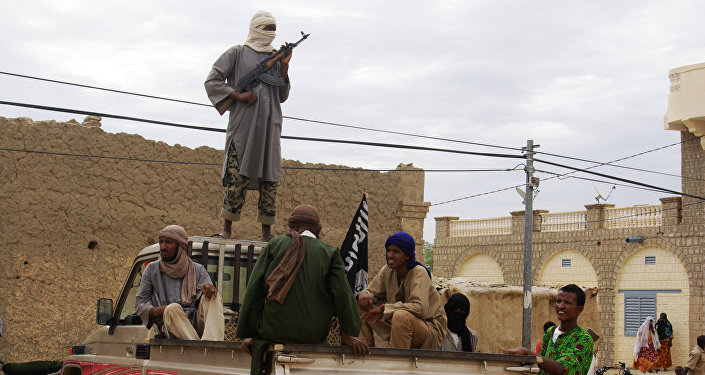 Fighters from the al-Qaida-linked Islamist group stand guard in Timbuktu, Mali (File)