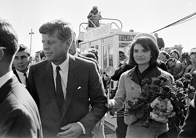 President John F. Kennedy and his wife Jacqueline Kennedy are greeted by an enthusiastic crowd upon their arrival at Dallas Airport, on November 22, 1963. Only a few hours later the president was assassinated while riding in an open-top limousine through the city.