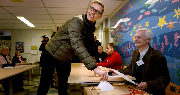 Finnish Prime Minister and leader of National Coalition Party Alexander Stubb casts his vote during the parliamentary election in Espoo, Finland