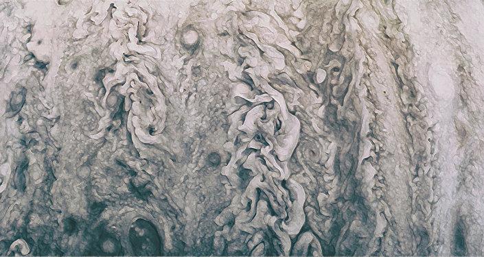 Uma representação artística da foto de Júpiter tirada pela sonda Juno denominada Mãe de Pérolas