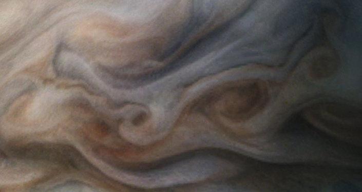 Apresentação da superfície de júpiter baseada numa foto transmitida pela sonda Juno