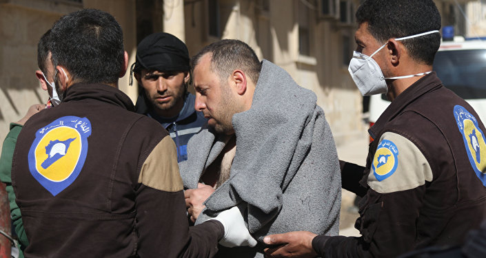 A Syrian man is taken by civil defence workers to a small hospital in the town of Maaret al-Noman following a suspected toxic gas attack in Khan Sheikhun, a nearby rebel-held town in Syria's northwestern Idlib province