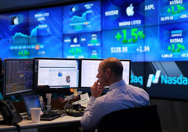 A trader works at the Nasdaq MarketSite in New York