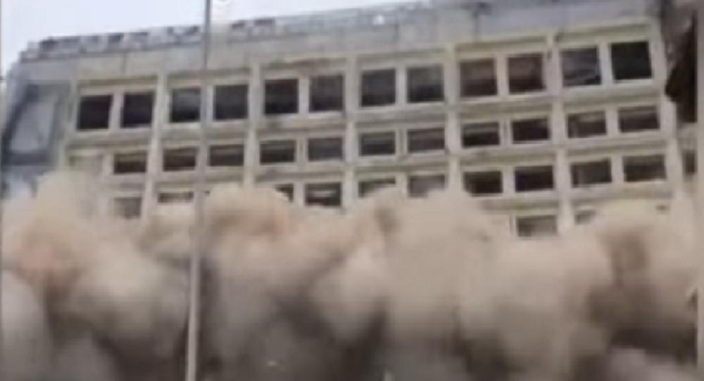demolição do prédio na China