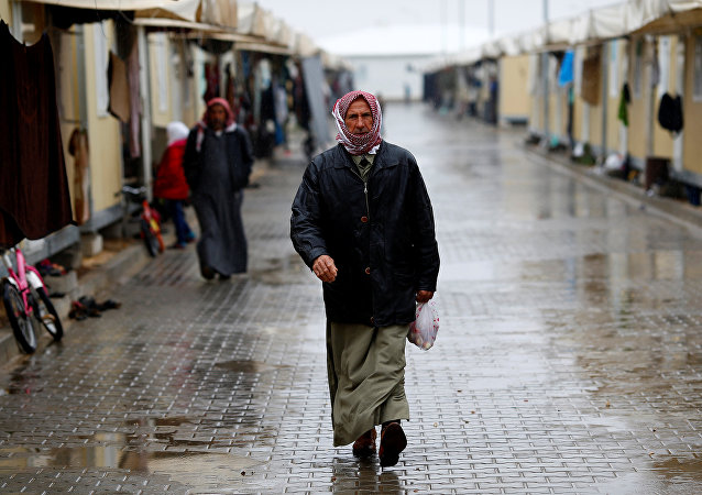 A Syrian refugee man walks in Elbeyli refugee camp near the Turkish-Syrian border in Kilis province, Turkey, December 1, 2016