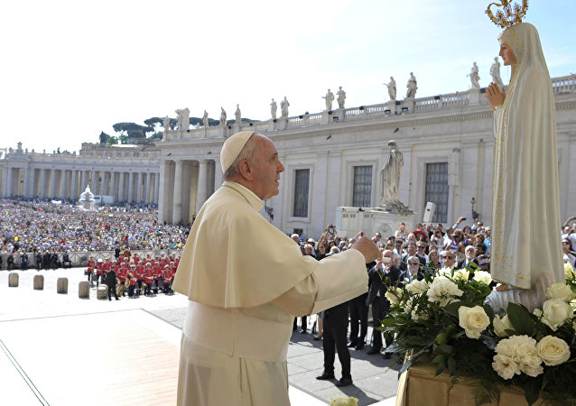 Pope Francis pays homage to the statue of St. Mary of Fatima during his weekly general audience in St. Peter's Square at the Vatican, Wednesday, May 13, 2015.