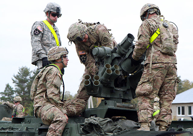 Members of the US Army 1st Brigade, 1st Cavalry Division, prepare Stryker Armored Vehicles at the railway station near the Rukla military base in Lithuania. (File)