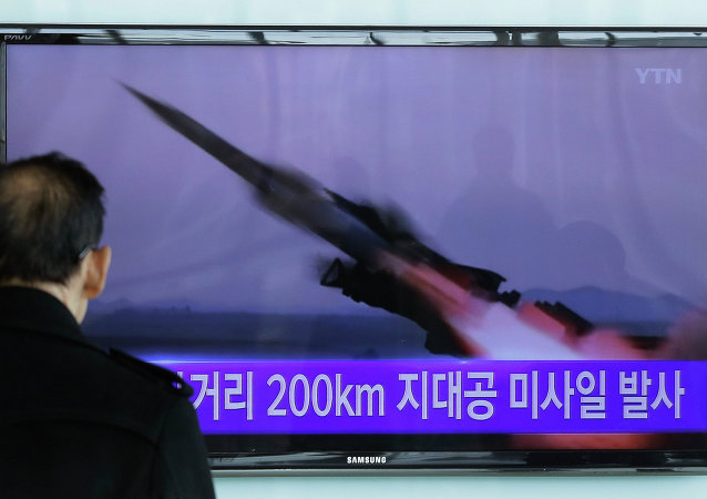 A South Korean man watches a TV news program showing the file footage of the missile launch conducted by North Korea.