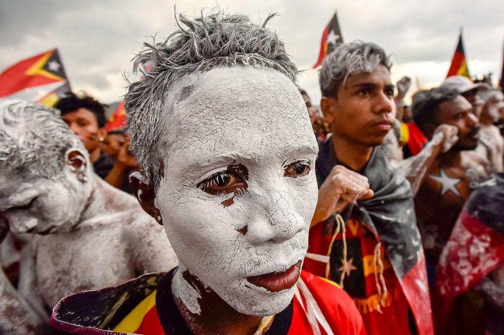 Participando de comício durante campanha eleitoral em Timor-Leste