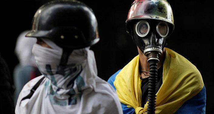 Manifestantes durante manifestação contra o governo do presidente da Venezuela, Nicolas Maduro, em Caracas