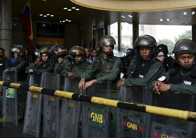 Venezuela's National Guards stand guard at the National Electoral Council (CNE) headquarters in Caracas, Venezuela, April 21, 2016.