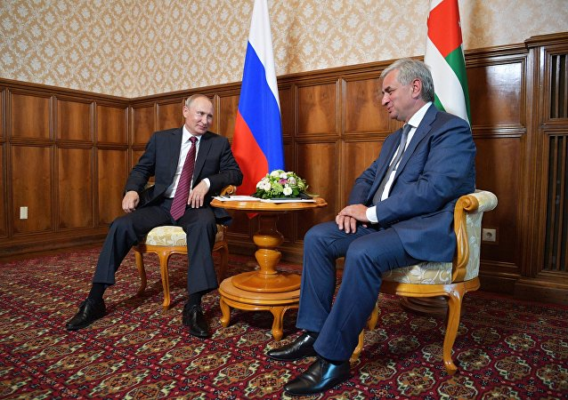 President Vladimir Putin and President of Abkhazia Raul Khadjimba, right, during a meeting