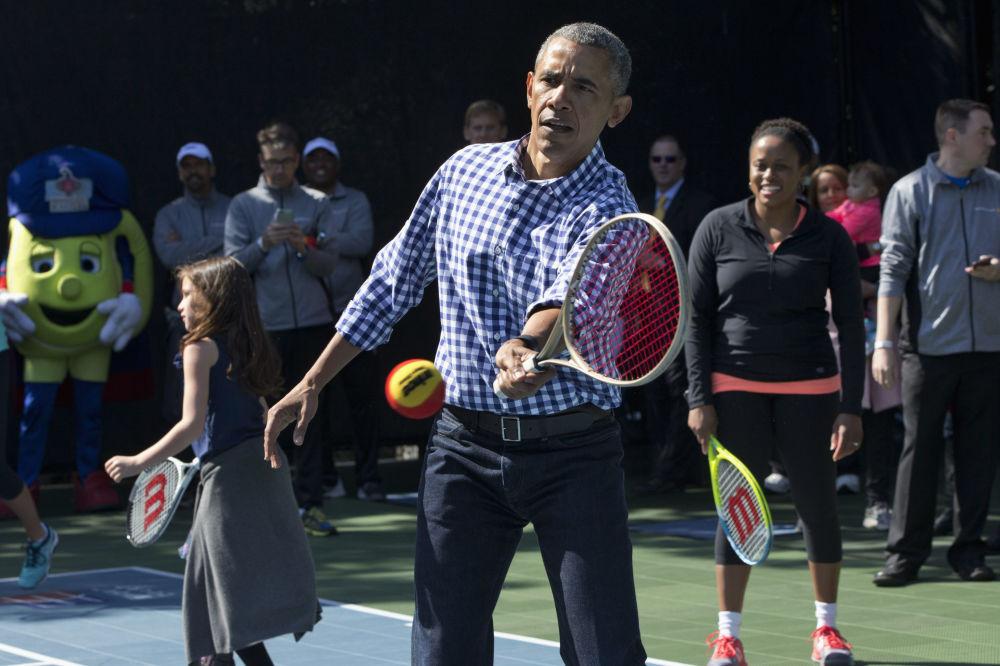 O ex-presidente dos EUA, Barack Obama, durante uma partida de tênis