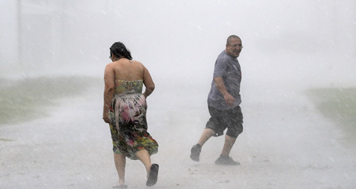 Texans run through the street during a band of heavy rain from Hurricane Harvey Saturday, Aug. 26, 2017, in Palacios, Texas.