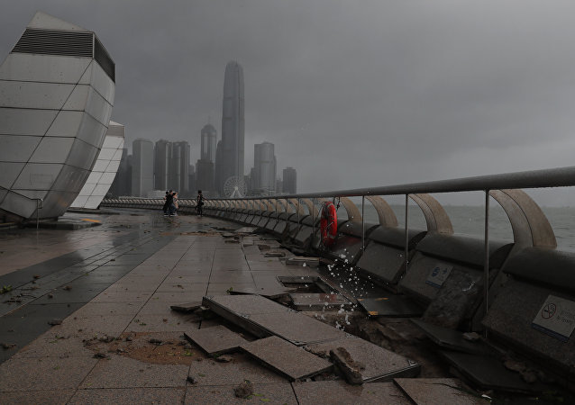 Debris caused by Typhoon Hato damage is strewn across the waterfront of Victoria Habour in Hong Kong, Wednesday, Aug. 23, 2017.