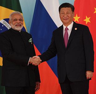 O líder chinês, Xi Jinping, e o primeiro-ministro indiano, Narendra Modi.