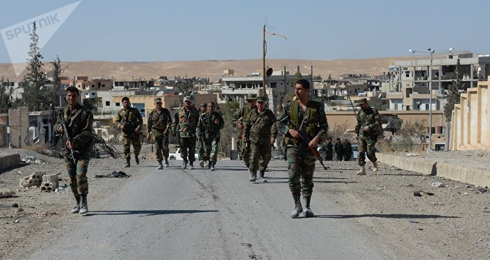 Tropas sírias na cidade de Al-Qaryatayn libertada de terroristas