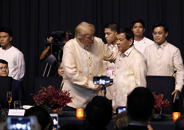 U.S. President Donald Trump shakes hands with Philippines President Rodrigo Duterte during the gala dinner marking ASEAN's 50th anniversary in Manila, Philippines November 12, 2017