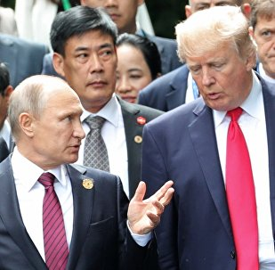 Russian President Vladimir Putin and US President Donald Trump are seen here ahead of the group photo ceremony for the Asia-Pacific Economic Cooperation leader
