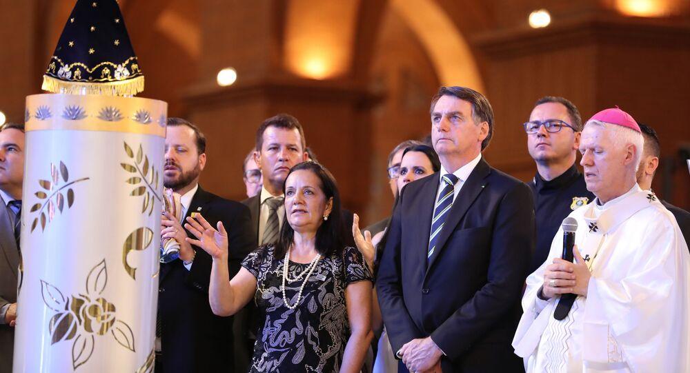 Jair Bolsonaro, presidente do Brasil, durante missa no Santuário Nacional de Nossa Senhora de Aparecida, em Aparecida, São Paulo, em 12 de outubro de 2019