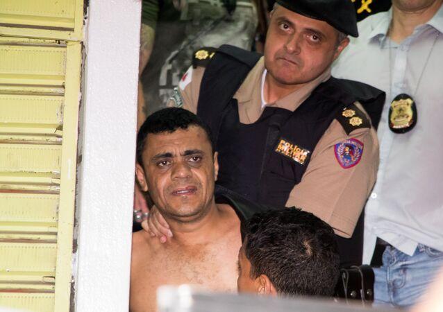 Em Juiz de Fora, Minas Gerais, Adélio Bispo é detido por policiais após esfaquear o então candidato à Presidência, Jair Bolsonaro, em 6 de setembro de 2018.