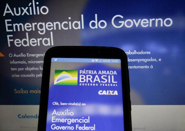 A tela do aplicativo da Caixa para o pagamento do auxílio emergencial, pago a partir de abril de 2020 em meio à pandemia do novo coronavírus no Brasil.