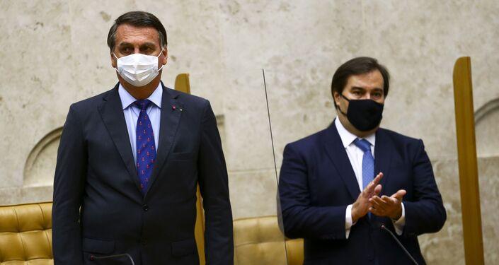 O presidente Jair Bolsonaro e o presidente da Câmara, Rodrigo Maia, durante cerimônia de posse do presidente do Supremo Tribunal Federal (STF), Luiz Fux, Brasília, 10 de setembro de 2020