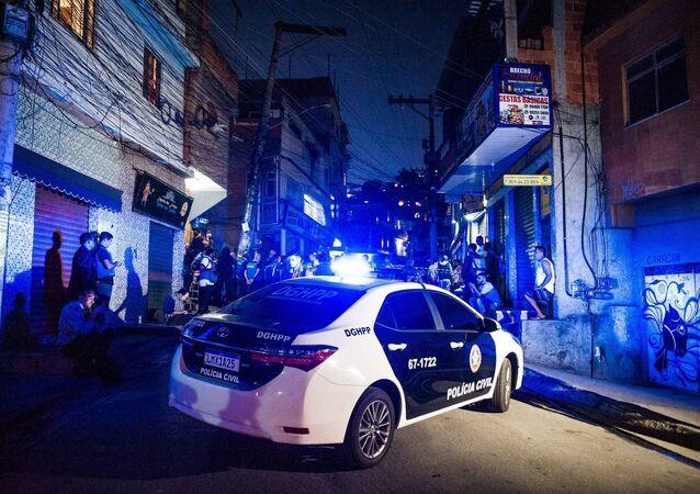 No Rio de Janeiro, a polícia realiza a perícia no local da reconstituição do caso do assassinato da menina Ágatha Félix, na rua Antônio Austregésilo, subida da localidade da Fazendinha, no Complexo do Alemão, em 1º de janeiro de 2019.