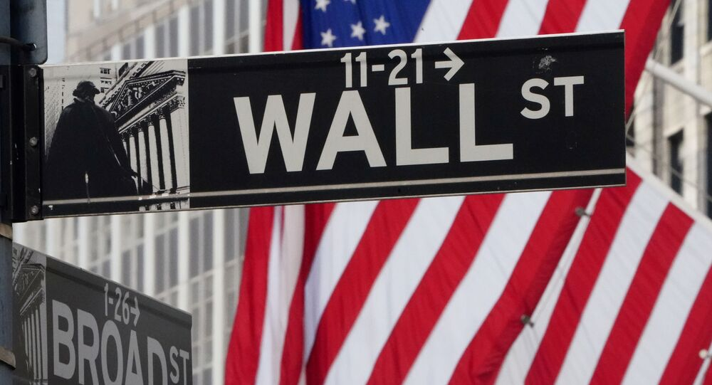 The Wall Street sign is pictured at the New York Stock exchange (NYSE) in the Manhattan borough of New York City, New York, U.S., March 9, 2020