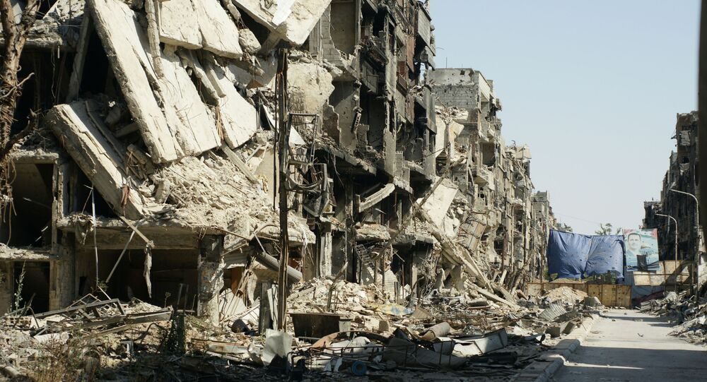 Edifícios no subúrbio de Damasco destruídos no decorrer da guerra civil na Síria (imagem referencial)