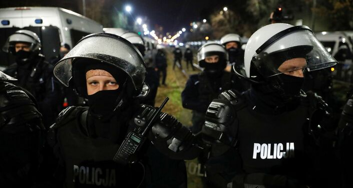 Police officers are seen during a protest against the ruling by Poland's Constitutional Tribunal that imposes a near-total ban on abortion, in Warsaw, Poland