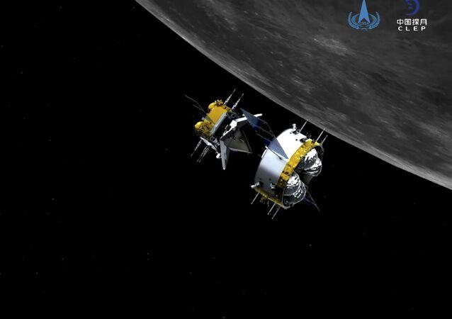 Simulação gráfica fornecida que mostra a combinação do orbitador-retornador da sonda Chang'e-5, da China. A sonda transferiu rochas da Lua para o orbitador em preparação para o retorno com as amostras para  a Terra.