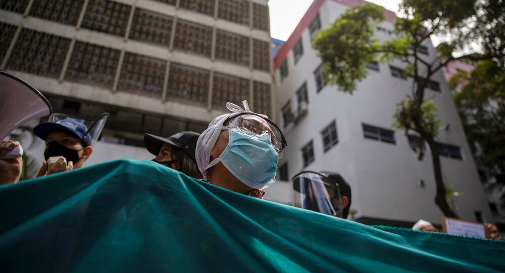 Trabalhadores de saúde protestam em Caracas, na Venezuela