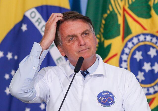 Presidente do Brasil, Jair Bolsonaro, durante cerimônia no Palácio do Planalto, Brasília, 12 de janeiro de 2021