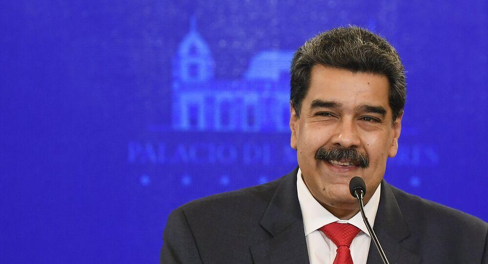 Presidente da Venezuela, Nicolás Maduro, sorrindo durante coletiva de imprensa