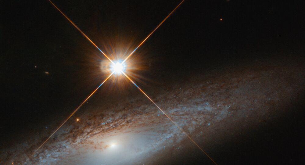 Imagem do Hubble mostra a galáxia espiral UGC 3885 na constelação de Lynx (Lince)