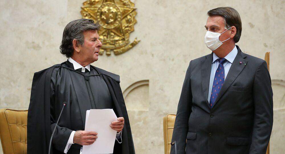 Jair Bolsonaro n sessão solene de posse dos senhores ministros Luiz Fux e Rosa Weber nos cargos de presidente e vice-presidente do Supremo Tribunal Federal.