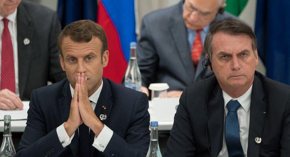 Presidente francês Emmanuel Macron ao lado do mandatário brasileiro Jair Bolsonaro durante a cúpula do G20, no Japão, em 2019