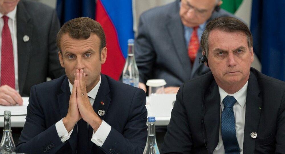 Presidente francês Emmanuel Macron ao lado do mandatário brasileiro Jair Bolsonaro durante a cúpula do G20, no Japão, no dia 28 de junho de 2019