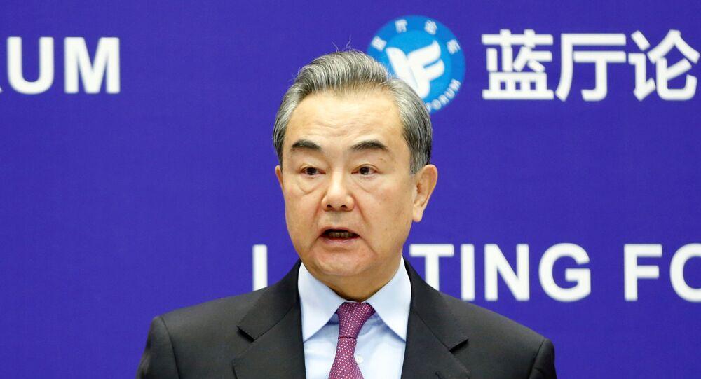 Ministro das Relações Exteriores da China, Wang Yi, discursa em Pequim, China, 22 de fevereiro de 2021